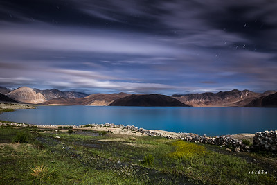 Pangong lake lit up by moonlight