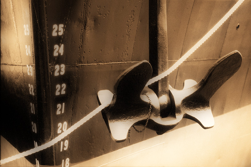 Ship anchor, mooring rope and displacement numbers painted on the bow of a dry docked ship in north Lake Union, Seattle, Washington.