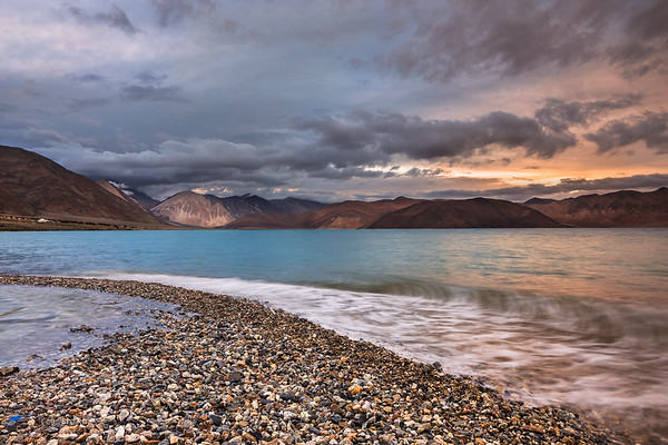 Last rays of the setting sun, turquoise colors of Pangong lake, pebbles that lead to the lake ,approaching waves and painting like mountains!! So many elements of interest that capture your imagination