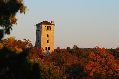 Late afternoon sun, combined with fall colors on the trees adds a warm hue to the water tower at Ha Ha Tonka State Park outside Camdenton, MO.