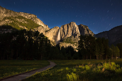 May 26th- The granite tower and Yosemite falls come alive as near full moon rises from behind. It was a sight to be seen. The fall was gleaming in moonlight. I took this picture at midnight. Also note the star trails in the sky.This is the time of the year when Yosemite valley is at its best. Flowers, meadows and gushing waterfalls !! It was an experience of life time! Can't describe the feeling in a few words.