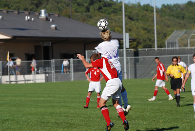 Rayder Bennett of the Camdenton Laker soccer team goes up for a header against a visiting team.