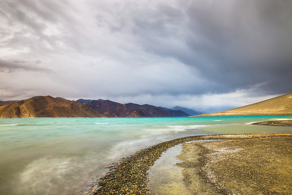The storm allowed for filtered light to hit Pangong lake and brought out its emerald green colors! At other times it looked deep blue and aquamarine. The color of the lake changes at different times of the day based upon the direction of the sun as well as the type of light at that time!