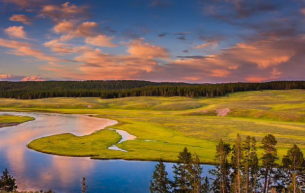 Hayden valley and yellowstone river during sunset. Clouds contributed to spectacular sunset! In June, the snow had just melt and the meadows were lush green.
