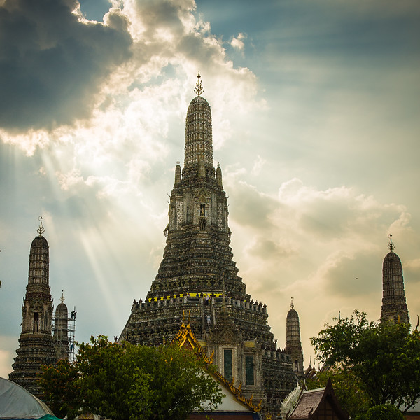 Temple of the Dawn - an iconic porcelain covered temple in Bangkok.  People can climb up very steep stairs part way up, but not all the way to the Buddha.