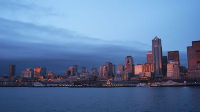 #4305 - Seattle Skyline at Dusk  Taking the ferry across Puget Sound from Seattle, the evening sunset shed a beautiful pink hue on the city's skyline.
