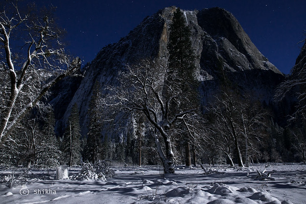 Cathedral Rock in Yosemite in full moonlight after snow storm