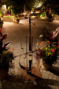 Iron/wire guitar, available at Butchart Gardens. I like the look of the image captured with available light.