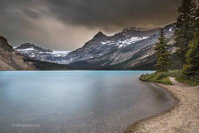 Rainstorm around sunset at bow lake, canada