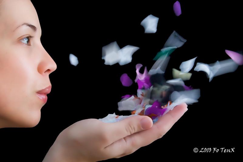 Blowing confetti kisses