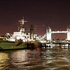 Fall 2007 - England.  A night photo of HMS Belfast, which is moored on the south bank of the Thames and the Tower Bridge in the background.  A small part of the Tower of London can be seen on the far left.