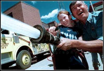 © Paul Conrad/ Pablo Conrad Photography  Aspen Elementary student Molly Rosenstein, 7, is helped by Aspen Volunteer Fire Department captain Jess Graber of the AVFD during a visit to the downtown fire barn in Aspen, Colo.