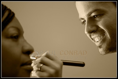 © Paul Conrad/Pablo Conrad Photography  CoCo & Company make-up artist Antonio Cejudo finishes a client during the Seattle SMUG Cancer Survivor's portrait session at the Baroness Hotel in Seattle, Wash.