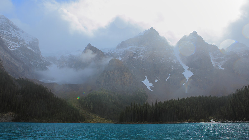 Kayaking on Moraine Lake during a passing snow/rain storm. To the bottom right is the glacial stream feeding the lake.