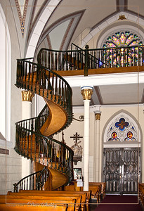 Loretto Chapel, in Santa Fe.  This is the miraculous staircase...it has two 360 degree turns and no visible means of support. Also, it is said that the staircase was built without nails—only wooden pegs. Questions also surround the number of stair risers relative to the height of the choir loft and about the types of wood and other materials used in the stairway's construction.