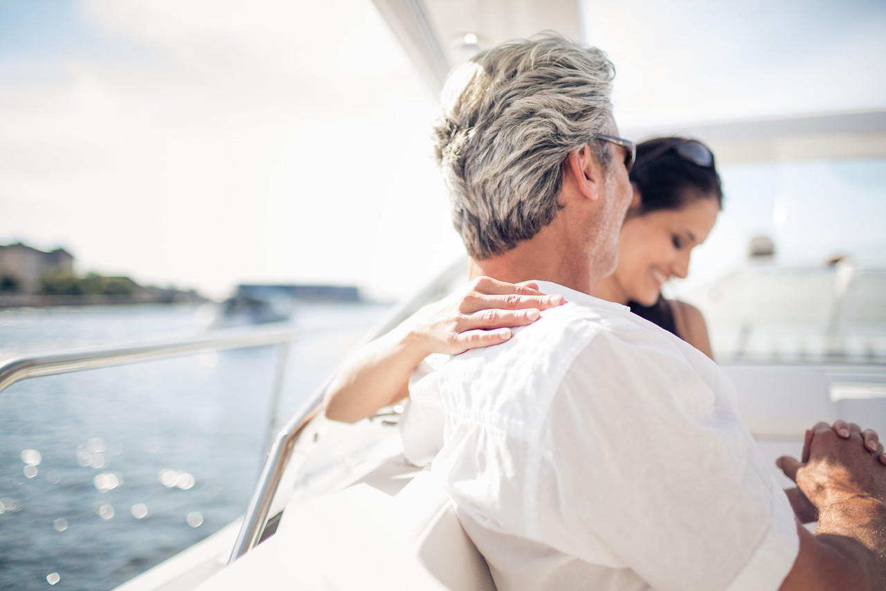Couple on a yacht enjoying a laugh in the sun.