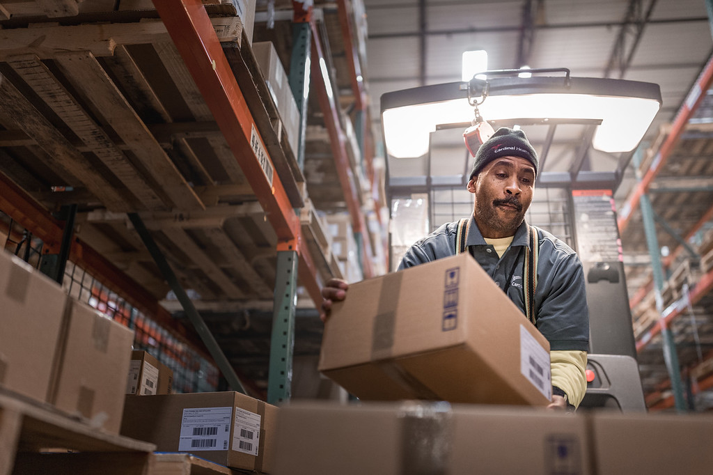 A man on a forklift working.