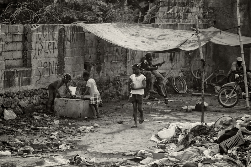 Two girls drawing from a contaminated well
