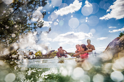 Family playing on lazy river