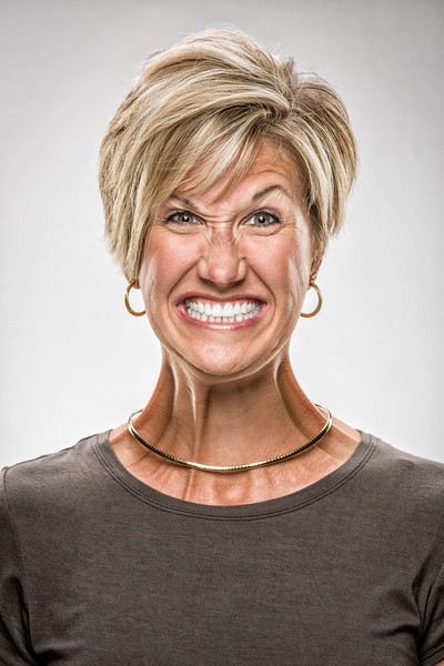 Caucasian woman expressing a funny face.