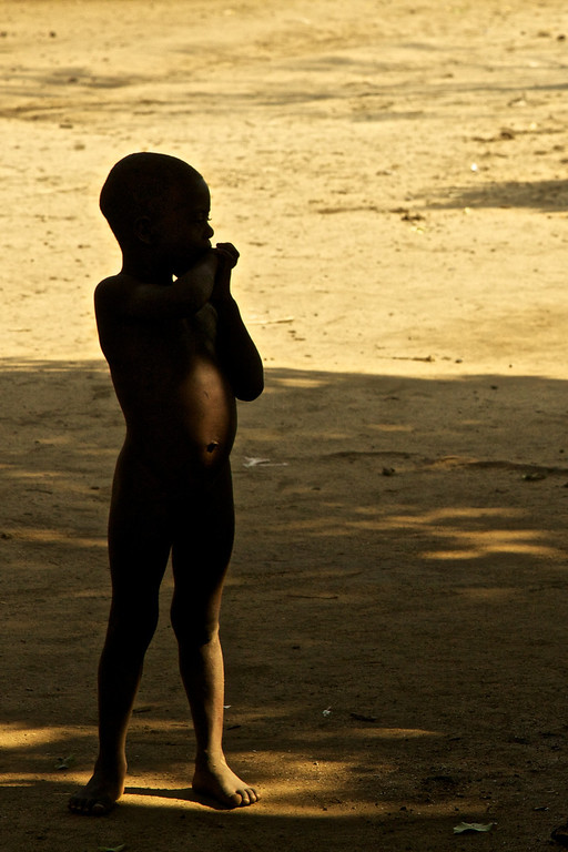 Closed the aperture down to make this little nude boy a silhouette for discretion.