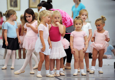 A group of young ballerinas wait their turn to perform an exercise during Ballet Mississippi's Summer Workshop for age 3-5 on Monday at the Mississippi Arts Center in Jackson.  The four-day workshop concludes Thursday.
