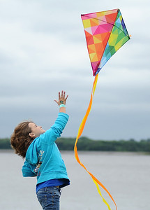 Jaycee Pilcher, 9, of Richland, tries to launch a kite into an uncooperatve breeze while at Old Trace Park in Ridgeland with her friend Elizabeth Martin and Elizabeth's mother, Emily Martin, on Saturday during the city's annual Waterfest.  Music, food and games entertained those willing to brave the unseasonable cool weather.