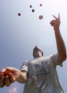 Despite the sun glaring overhead, Ed Carstens of Madison is able to juggle seven beanbags Saturday morning at the Dr. Hugh G. Ward Children's Playground at Parham Bridges Park on Ridgewood Road in Jackson. Members of the Jackson Area Jugglers meet every Saturday at the park to practice from 10 a.m. to noon.