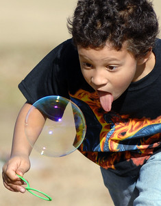 Landon Boyd, 7, of Pearl, tries to catch a bubble with his mouth while on a family outing on a beautiful Sunday afternoon at Old Trace Park in Ridgeland.