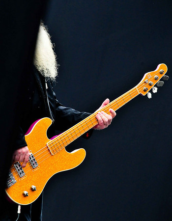 Dusty Hill of ZZ Top plays at the Texas Motor Speedway before the NASCAR Dickies 500 Sprint Cup race in November 2009.