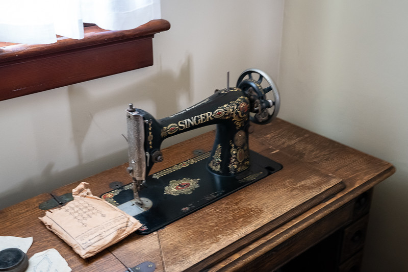 Singer treadle sewing machine in a servant's room, Fenyes Mansion