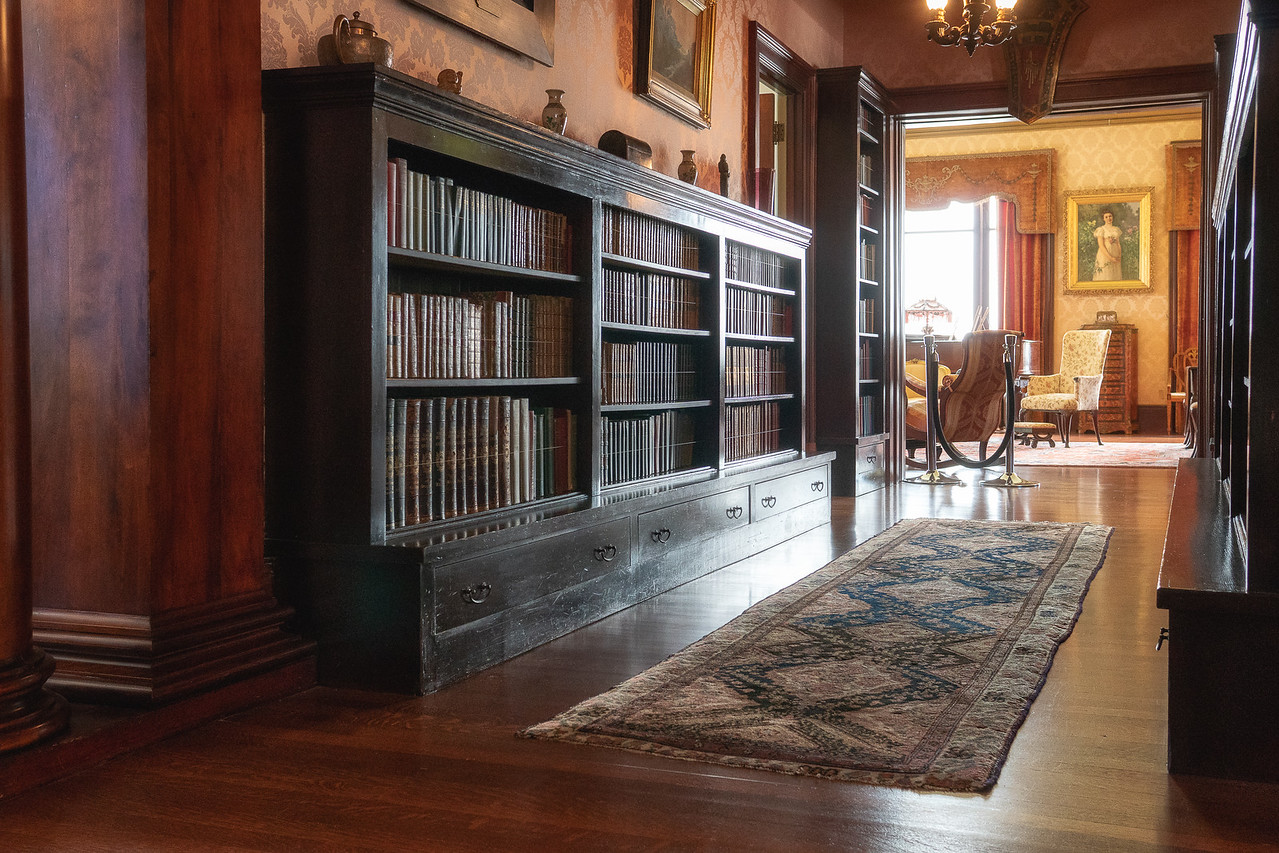 Books line the hall, a pseudo-library at Fenyes Mansion