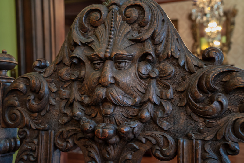 Ornately carved back of dining room chair, Fenyes Mansion