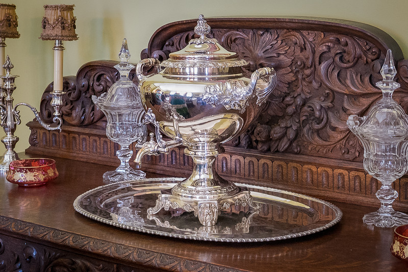 Ornate sideboard with silver and crystal dishes, Fenyes Mansion