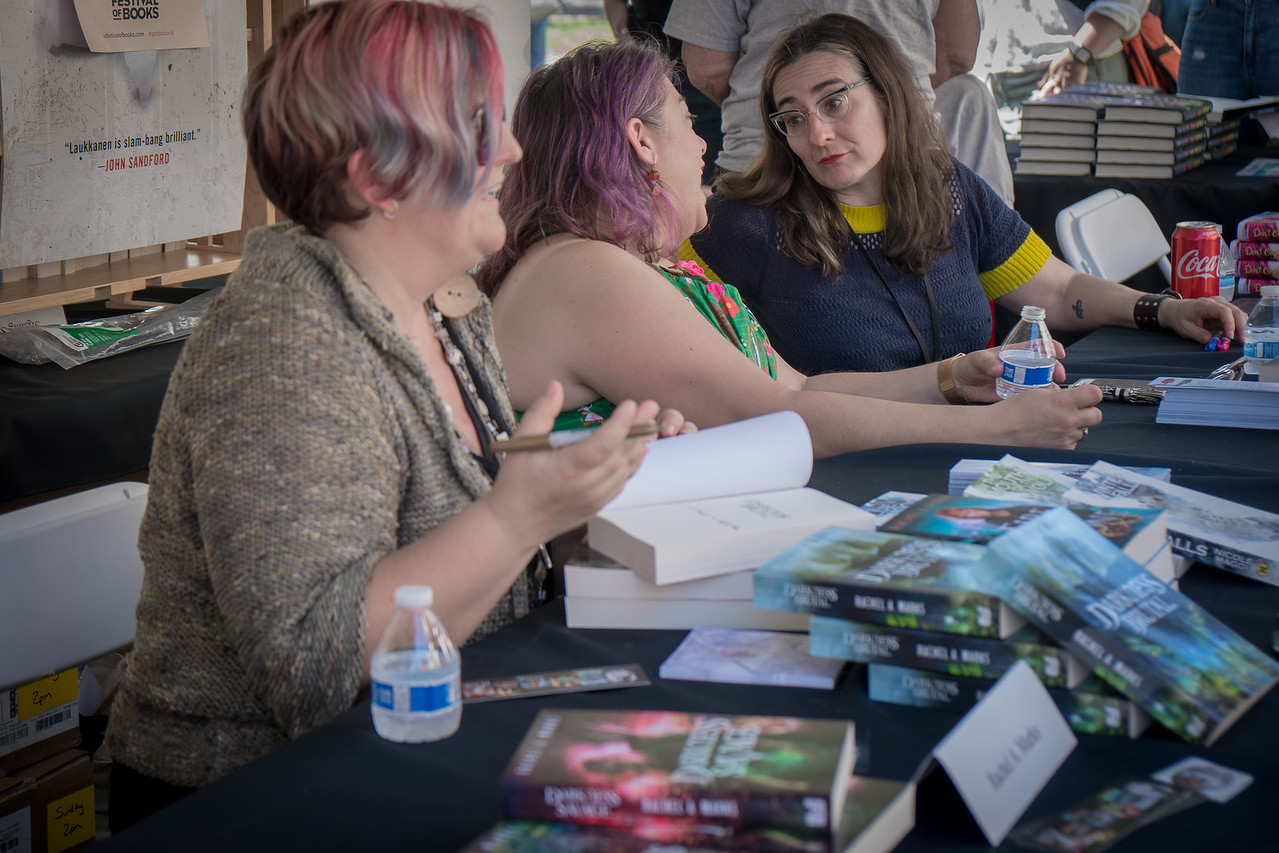 Rachel A. Marks, Nicole Maggi, and Cecil Castellucci having a chuckle or two while signing