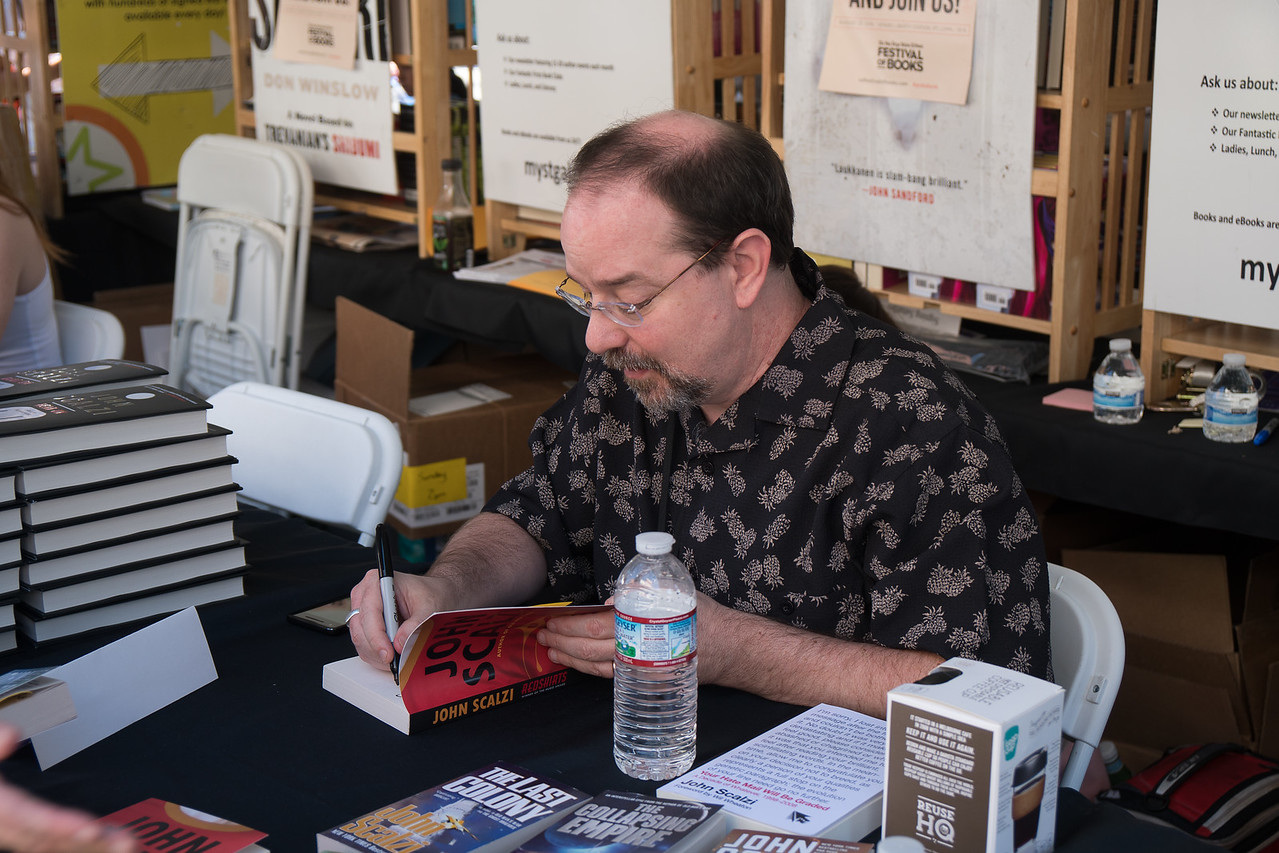 John Scalzi signing his book, Redshirts
