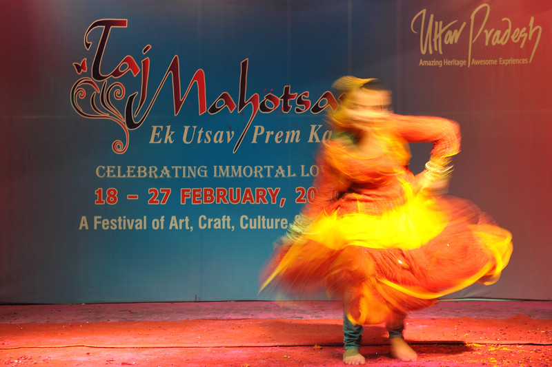 Girl doing a solo dance performance at a dance & music competition held for children. Throughout the Taj Mahotsav one experiences a profusion of folk & classical music & dances of various regions, especially the Brij Bhumi, performed the way they used to be centuries ago. Besides the folk, the Mahotsav also exhibit the performance from the world renowned artistes from classical, semi-classical and popular art forms. <br /> <br /> Taj Mahotsav (Hindi: ताज महोत्सव, Urdu: تاج مہوتسو, translation: Taj Jubilee) is an annual 10 day festival that takes place from 18th to 27th  February. The event is held at Shilpgram in Agra, India. This carnival is a vibrant platform that brings together India's finest craft and culture at one single place. It is a festive introduction to  India as a whole and Uttar Pradesh in particular, where the extensive range of  art,  craft, culture and cuisine are on display. Every year in February, tourists flock to Agra for this mega event, just a stone throw from the majestic Taj Mahal. This festival invokes the memories of old Mughal era and nawabi style prevalent in Uttar Pradesh in 18th and 19th centuries.<br /> <br /> Taj Mahotsav Ek Utsav Pyar Ka, Celebrating Immortal Love, 18-27 February, 2010. A festival of art, craft, culture and cusuine. North, Uttar Pradesh (UP), North India.