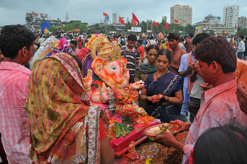 Small to giant idols of elephant-headed Hindu God Ganesha being taken to Chowpatty beach, Arabian sea in Mumbai, with dancing, beating of drums and grand celebrations for the Ganesh Chaturti festival.