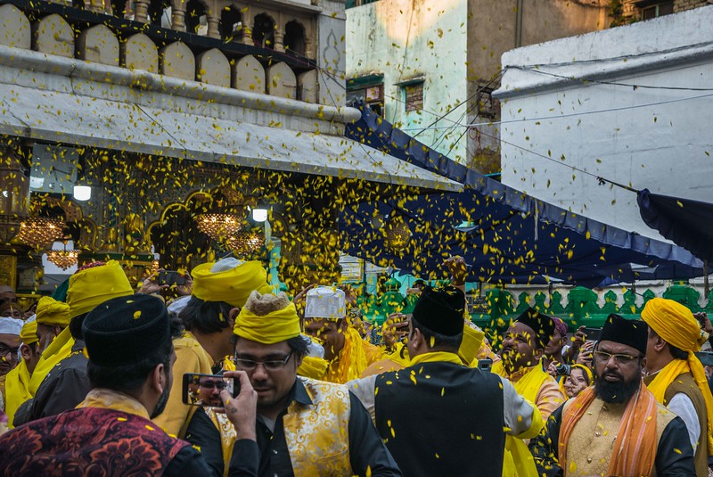 Joyful Crowd throws marigold petal leaves on performers as the beginning of spring. The yellow colour becomes a symbol of peace and prosperity.