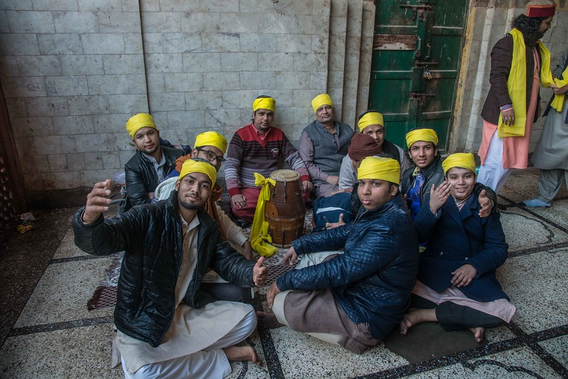 A group of super enthusiasts Qawwali performers possess front of the camera. They asked whether I am at TikTok or not.