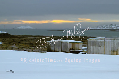 Arctic sunrise with fishing huts - Iqaluit, Nunavut, Canada