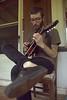 pickin away at his mandolin