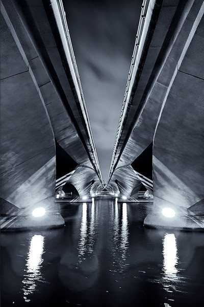 A tale of symmetry<br /> <br /> Amazing leading lines & vanishing point under 'Esplanade bridge' in the Marina bay in Singapore.<br /> <br /> 20 sec exposure. Nikkor 16-35 @ f8. B&W conversion with Nik Silver Efex