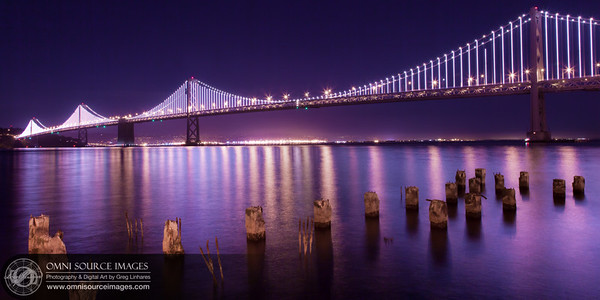 """The Bay Lights"" art installation. The San Francisco-Oakland Bay Bridge was recently outfitted with an enormous bank of 25,000 LED lights by artist Leo Villareal. This image was captured during a random testing sequence almost two-weeks before the official opening of the exhibit. Thursday, February 21, 2012 at 8:51 PM. 30 second exposure at f/11, ISO 100, 24mm."