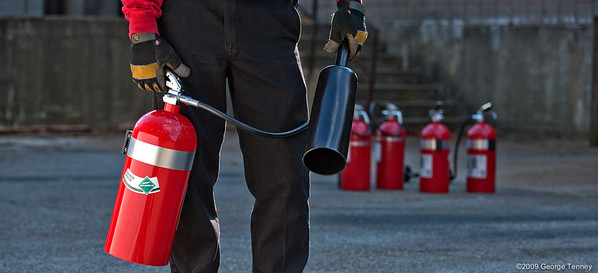 Technician with fire extinguisher