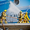 "Tucson International Airport (TIA) fire crew train for the rare occasion of an airplane on fire. This piece (40x62"") was purchased by TIA and installed in their permanent collection within the airport."