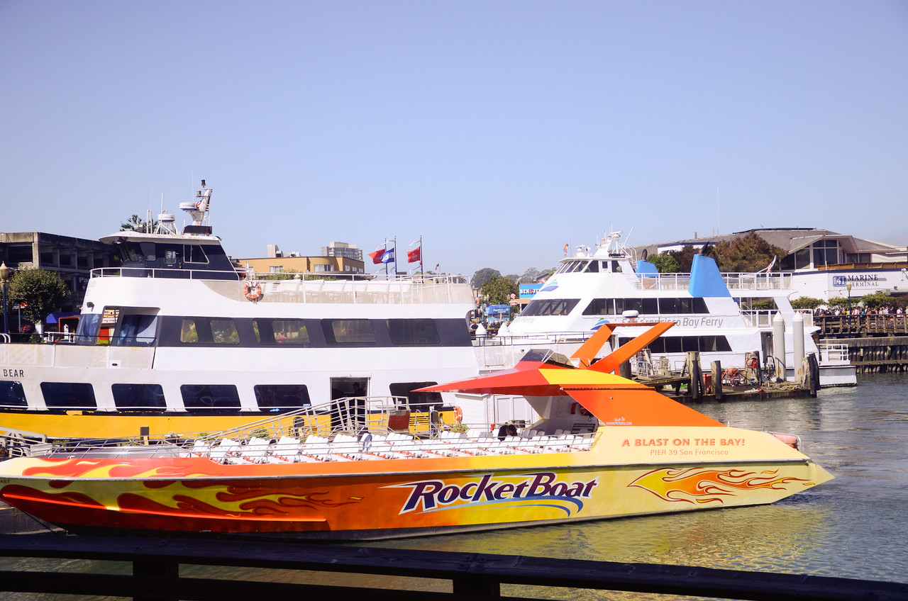 Tour boats and ferries docked along Fisherman's Wharf