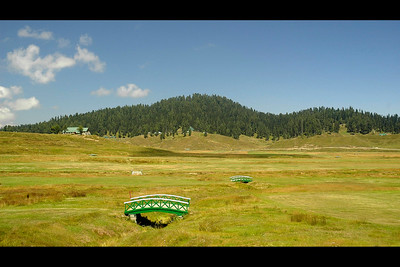 Golf Course in Gulmuhar, Kashmir, J&K, India.  Terraced lawns, bright flowerbeds and lush green trees.