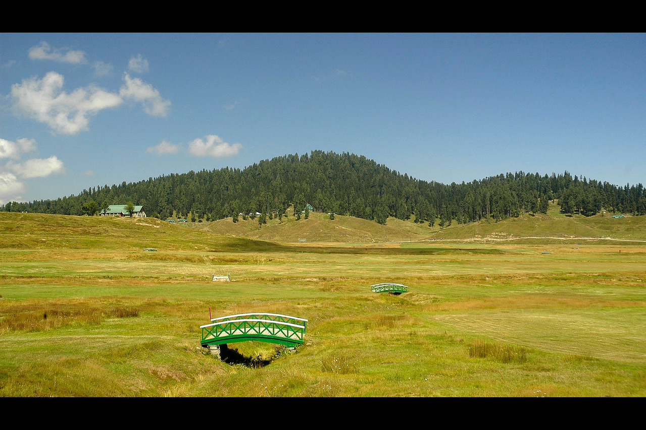 Golf Course in Gulmuhar, Kashmir, J&K, India.<br /> <br /> Terraced lawns, bright flowerbeds and lush green trees.