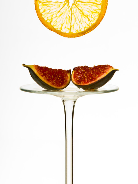 Two figs on a reversed glass